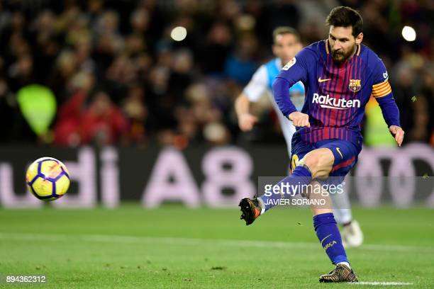 Barcelona's Argentinian forward Lionel Messi kicks a penalty shot during the Spanish league football match FC Barcelona against RC Deportivo de la...