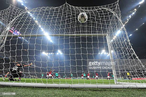 Barcelona's Argentinian forward Lionel Messi kicks and score a penalty during the Champions League group H football match AC Milan vs FC Barcelona on...