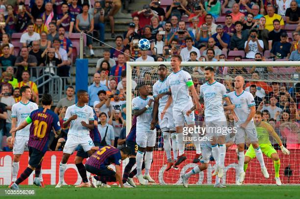 Barcelona's Argentinian forward Lionel Messi kicks the ball and scores during the UEFA Champions' League group B football match FC Barcelona against...