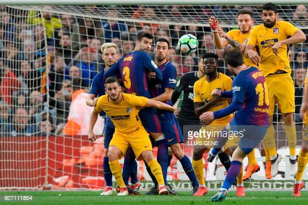 TOPSHOT Barcelona's Argentinian forward Lionel Messi kicks the ball and scores during the Spanish league football match FC Barcelona against Club...
