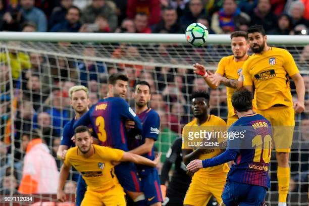 Barcelona's Argentinian forward Lionel Messi kicks the ball and scores during the Spanish league football match FC Barcelona against Club Atletico de...