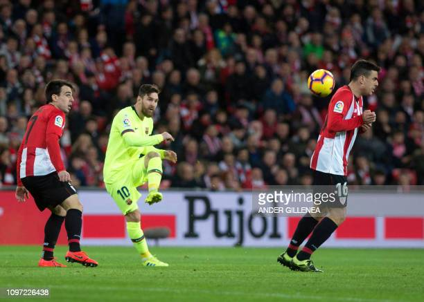 Barcelona's Argentinian forward Lionel Messi kicks the ball during the Spanish league football match Athletic Club Bilbao against FC Barcelona at the...