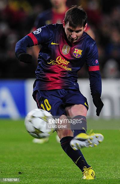 Barcelona's Argentinian forward Lionel Messi kicks the ball during the UEFA Champions League football match FC Barcelona vs SL Benfica at the Camp...