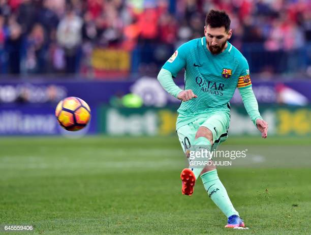 TOPSHOT Barcelona's Argentinian forward Lionel Messi kicks the ball during the Spanish league football match Club Atletico de Madrid vs FC Barcelona...