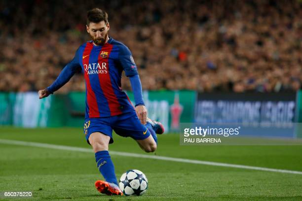 Barcelona's Argentinian forward Lionel Messi kicks the ball during the UEFA Champions League round of 16 second leg football match FC Barcelona vs...