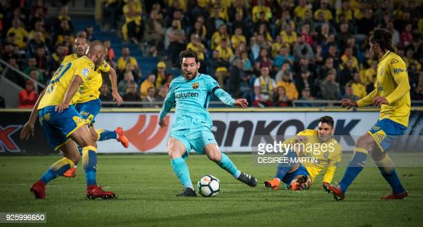 Barcelona's Argentinian forward Lionel Messi kicks the ball during the Spanish league football match UD Las Palmas vs FC Barcelona at the Gran...