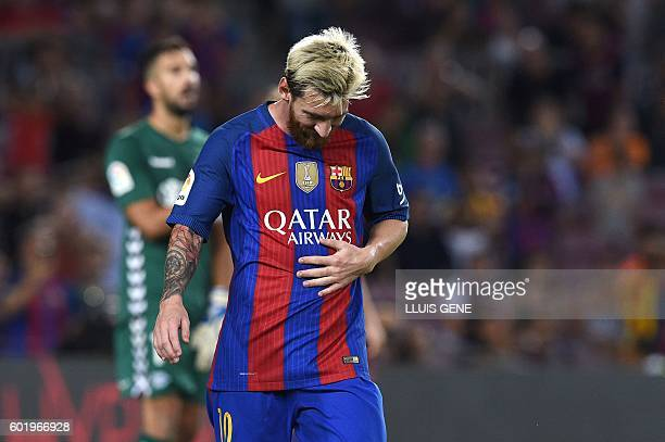 Barcelona's Argentinian forward Lionel Messi leaves the pitch at the end of the Spanish league football match FC Barcelona vs Deportivo Alaves at the...