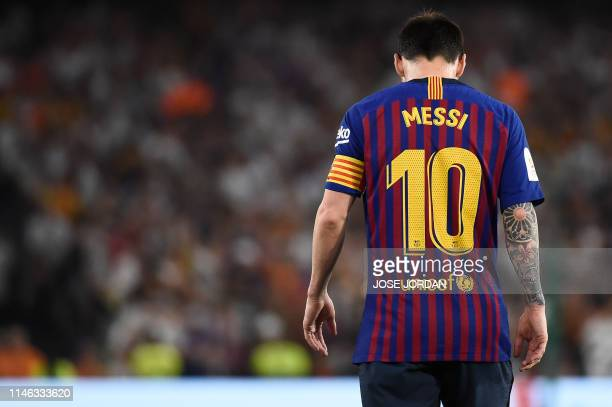 Barcelona's Argentinian forward Lionel Messi looks downards during the 2019 Spanish Copa del Rey final football match between Barcelona and Valencia...