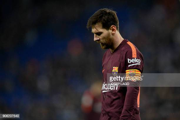 TOPSHOT Barcelona's Argentinian forward Lionel Messi looks downwards during the Spanish 'Copa del Rey' quarterfinal first leg football match between...