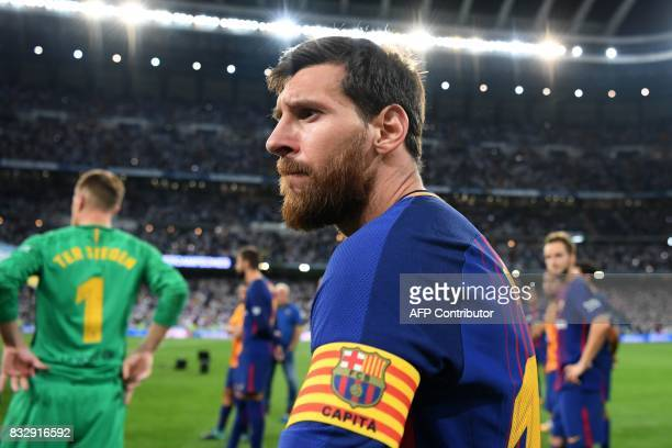 Barcelona's Argentinian forward Lionel Messi looks on after being defeated by Real Madrid at the end of the second leg of the Spanish Supercup...