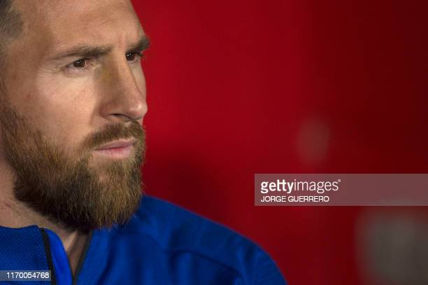 TOPSHOT Barcelona's Argentinian forward Lionel Messi looks on before the Spanish league football match between Granada FC and FC Barcelona at Nuevo...