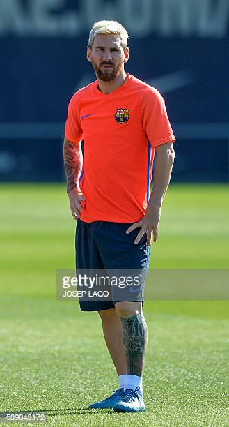 Barcelona's Argentinian forward Lionel Messi looks on during a training session at the Sports Center FC Barcelona Joan Gamper in Sant Joan Despi near...