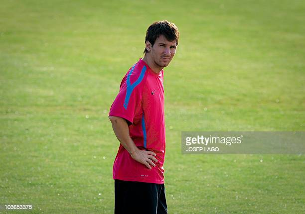 FC Barcelona's Argentinian forward Lionel Messi looks on during a training session on August 27 at the FC Barcelona Joan Gamper Sport center near...