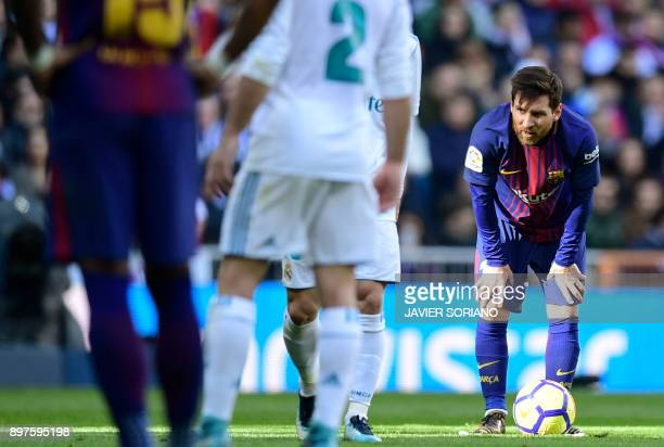 Barcelona's Argentinian forward Lionel Messi looks on during the Spanish League 'Clasico' football match Real Madrid CF vs FC Barcelona at the...