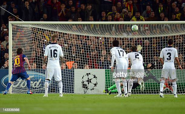 Barcelona's Argentinian forward Lionel Messi misses a penalty shot against Chelsea's Czech goalkeeper Petr Cech during the UEFA Champions League...
