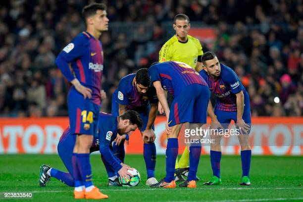Barcelona's Argentinian forward Lionel Messi places the ball before taking a freekick and scoring during the Spanish league football match between FC...