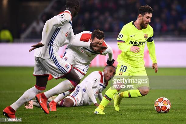Barcelona's Argentinian forward Lionel Messi plays the ball during the UEFA Champions League round of 16 first leg football match between Lyon and FC...