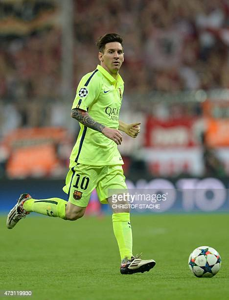 Barcelona's Argentinian forward Lionel Messi plays the ball during the UEFA Champions League semifinal second leg football match FC Bayern Munich vs...