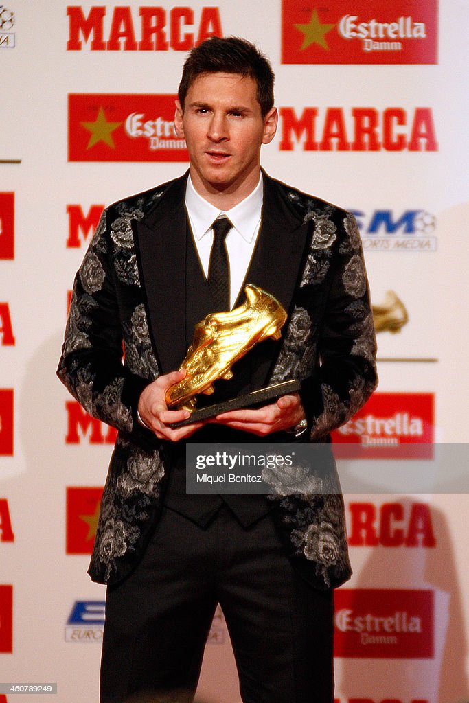 Barcelona's Argentinian forward Lionel Messi poses after receiving his Golden Boot 2013 award, presented to Europes best goal scorer of the 2012-2013 season on November 20, 2013 in Barcelona Spain.