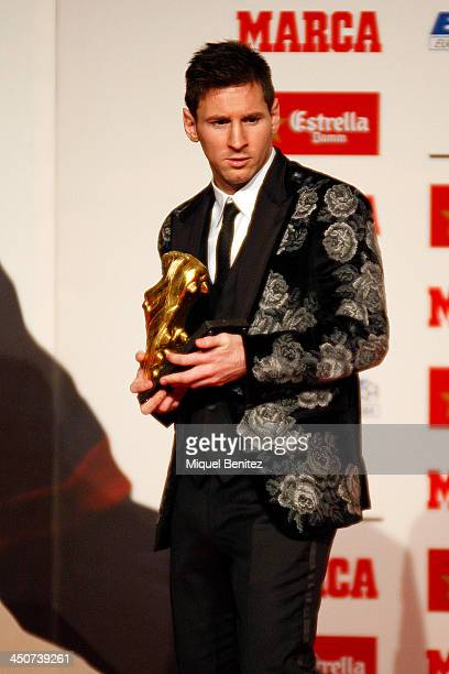 Barcelona's Argentinian forward Lionel Messi poses after receiving his Golden Boot 2013 award presented to Europes best goal scorer of the 20122013...