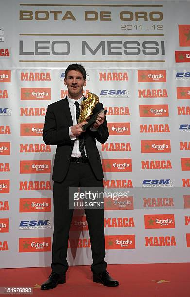 Barcelona's Argentinian forward Lionel Messi poses after receiving the European Golden Boot 2012 award for best European goalscorer of the 20112012...