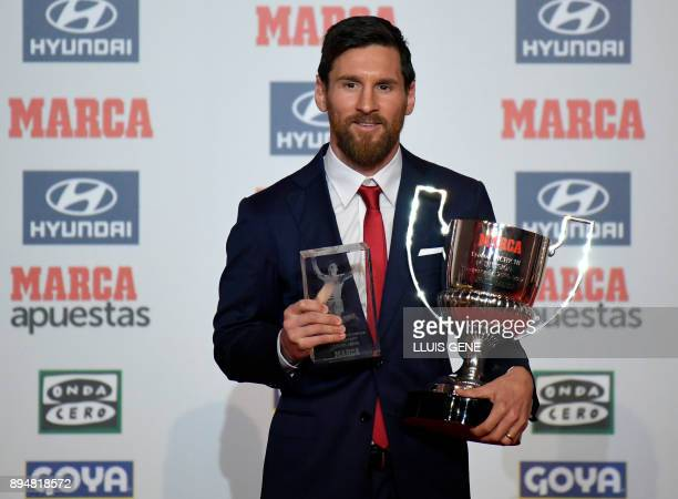TOPSHOT Barcelona's Argentinian forward Lionel Messi poses after receiving the Alfredo Diestefano award and the 'Pichichi' award for the 201617...