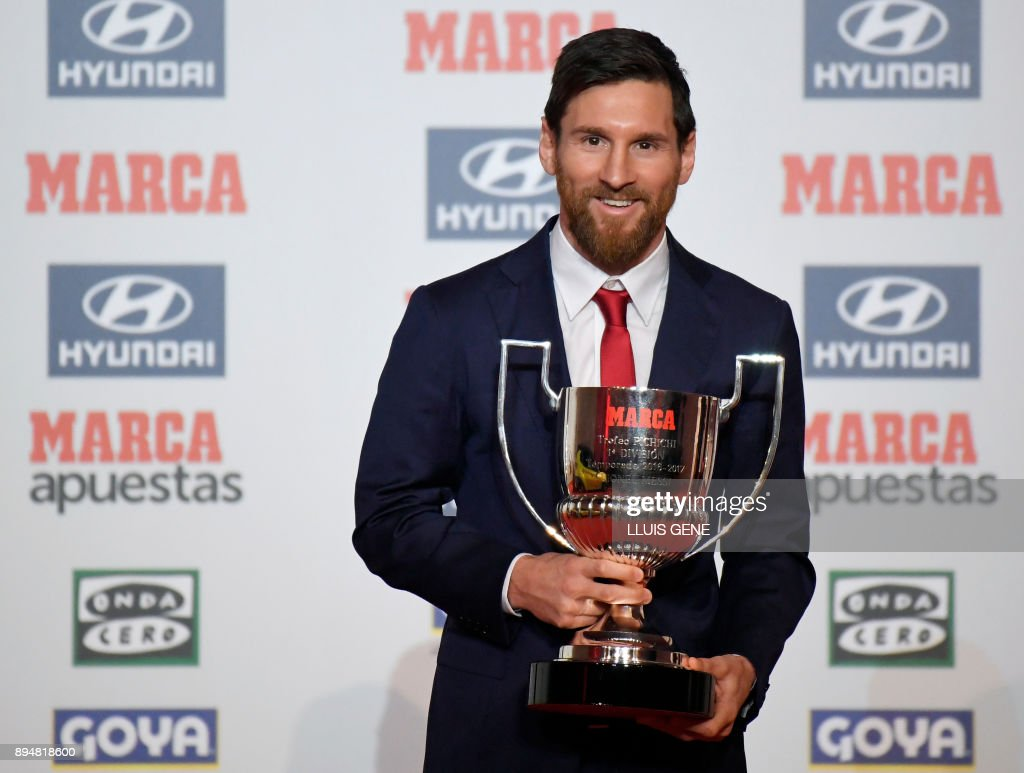 Barcelona's Argentinian forward Lionel Messi poses after receiving the 'Pichichi' award for the 2016-17 leading goalscorer of the Spanish league, in Barcelona on December 18, 2017. /