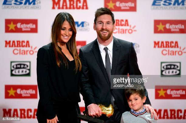Barcelona's Argentinian forward Lionel Messi poses his wife Antonella Roccuzzo and their son Thiago after receiving the 2017 European Golden Shoe...