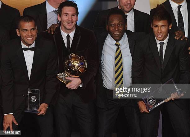 Barcelona's Argentinian forward Lionel Messi poses near Brazilian football legend Pele Barcelona's Brazilian Dani Alves and Santos FC' Brazilian...