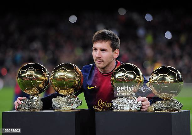 Barcelona's Argentinian forward Lionel Messi poses with his 4 FIFA Ballon d'Or trophies prior to the Spanish Copa del Rey quarterfinal football match...
