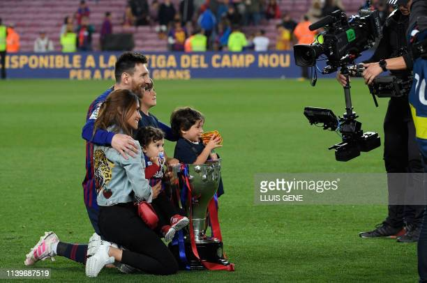 Barcelona's Argentinian forward Lionel Messi poses with his family as he celebrates becoming La Liga champions after winning the Spanish League...