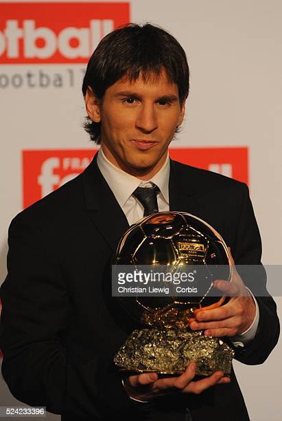 FC Barcelona's Argentinian forward Lionel Messi poses with his trophy after being awarded with 'Ballon d'Or' rewarding the best European footballer...
