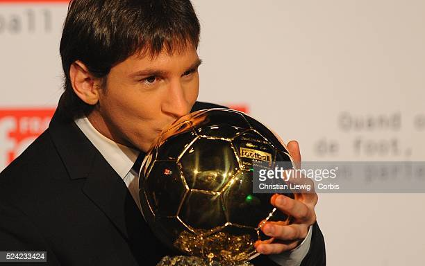 Barcelona's Argentinian forward Lionel Messi poses with his trophy after being awarded with 'Ballon d'Or' , rewarding the best European footballer of...