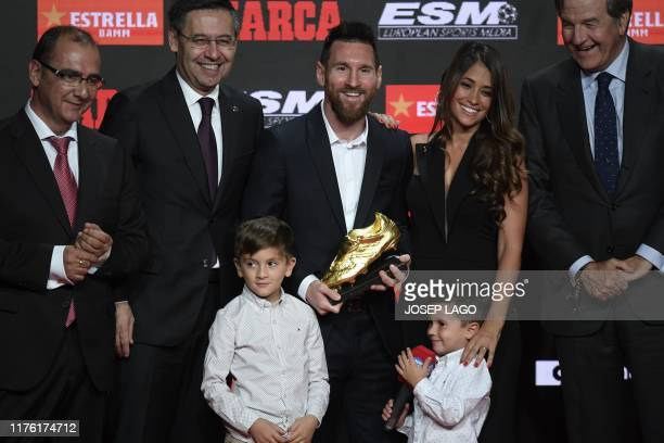 Barcelona's Argentinian forward Lionel Messi poses with his wife Antonella Roccuzzo and his sons Thiago and Mateo with his sixth Golden Shoe award...