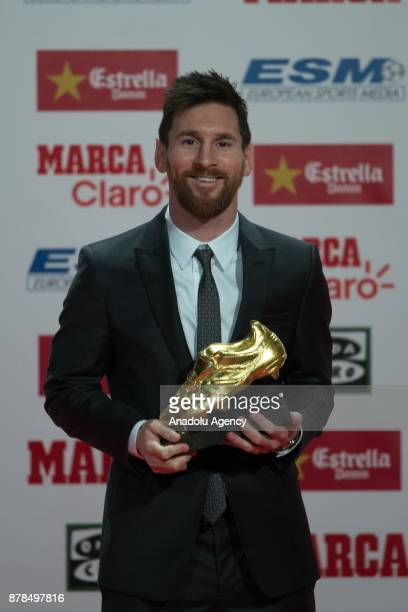 Barcelona's Argentinian forward Lionel Messi poses with the 2017 European Golden Shoe honouring the year's leading goalscorer during a ceremony at...