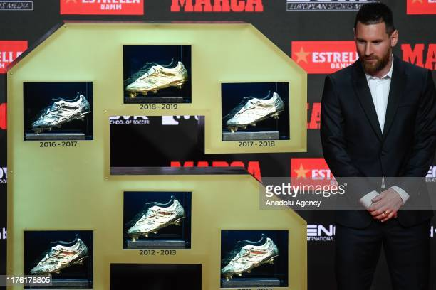 Barcelona's Argentinian forward Lionel Messi poses with the sixth European Golden Boot awards after receiving the 2019 European Golden Shoe honouring...