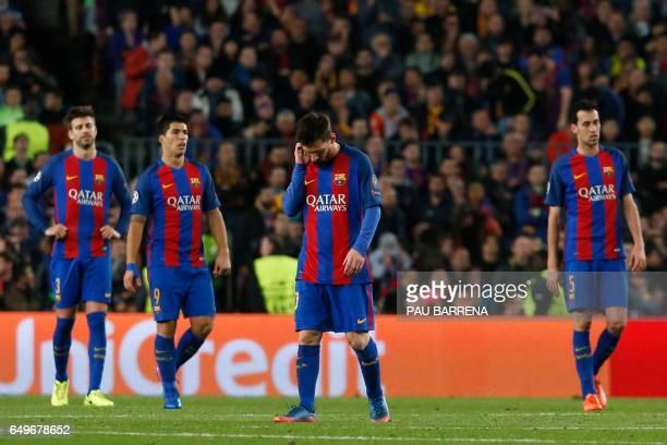 Barcelona's Argentinian forward Lionel Messi react after Paris SaintGermain's Uruguayan forward Edinson Cavani scored during the UEFA Champions...