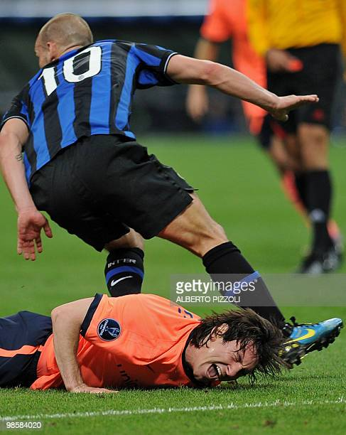 Barcelona's Argentinian forward Lionel Messi reacts after a tackle by Inter Milan's Dutch midfielder Wesley Sneijder during their UEFA Champions...