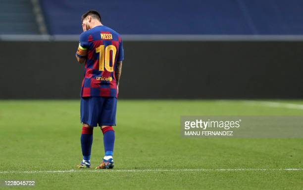 TOPSHOT Barcelona's Argentinian forward Lionel Messi reacts after Bayern Munich's second goal during the UEFA Champions League quarterfinal football...