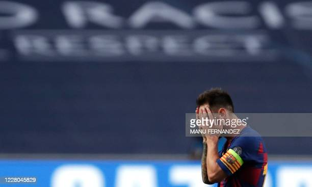 Barcelona's Argentinian forward Lionel Messi reacts after Bayern Munich's third goal during the UEFA Champions League quarterfinal football match...