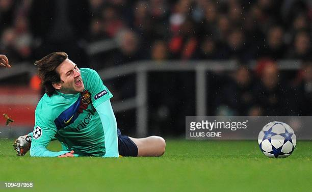 Barcelona's Argentinian forward Lionel Messi reacts after being fooled during the Champions League round of 16 first leg football match Arsenal vs FC...
