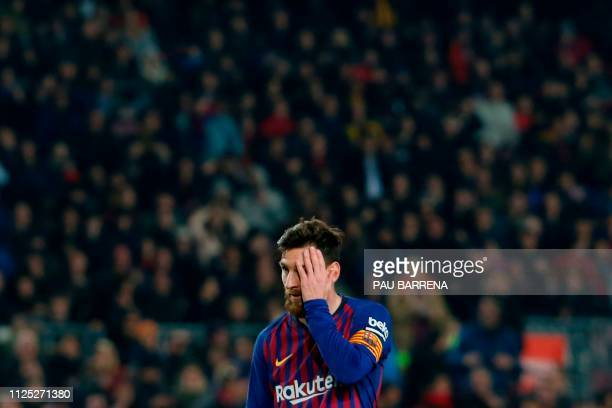 Barcelona's Argentinian forward Lionel Messi reacts after failing to score a penalty kick during the Spanish League football match between Barcelona...