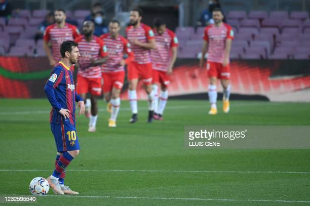 Barcelona's Argentinian forward Lionel Messi reacts after Granada's Spanish forward Jorge Molina scored during the Spanish League football match...