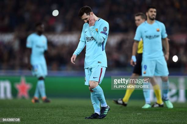 Barcelona's Argentinian forward Lionel Messi reacts after his team conceded a goal during the UEFA Champions League quarterfinal second leg football...