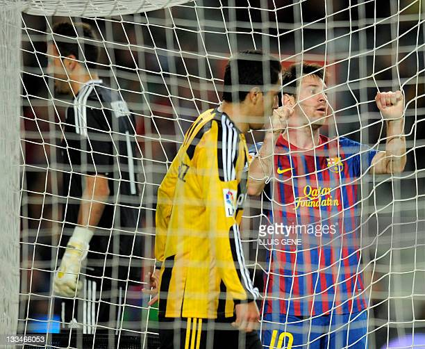 Barcelona's Argentinian forward Lionel Messi reacts after lossing a goal opportunity during the Spanish Liga football match between FC Barcelona and...