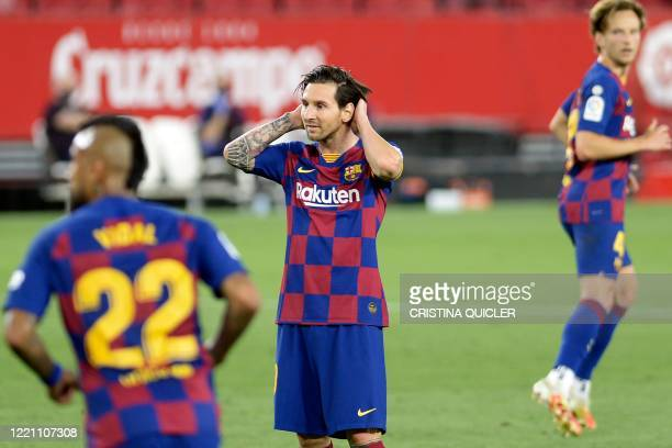 TOPSHOT Barcelona's Argentinian forward Lionel Messi reacts after missing a goal opportunity during the Spanish league football match between Sevilla...