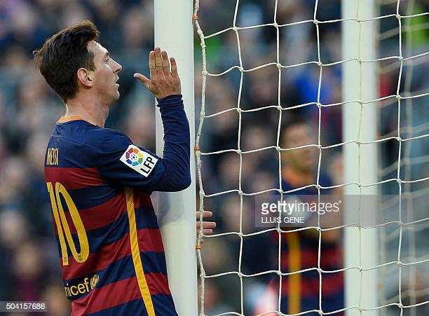 Barcelona's Argentinian forward Lionel Messi reacts after missing a goal during the Spanish league football match FC Barcelona vs Granada CF at the...