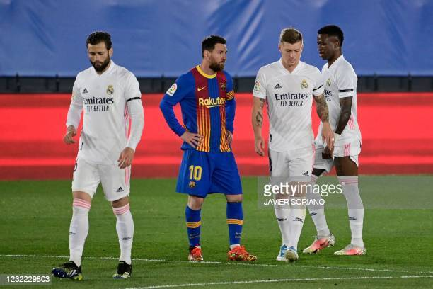 """Barcelona's Argentinian forward Lionel Messi reacts after Real Madrid's German midfielder Toni Kroos scored during the """"El Clasico"""" Spanish League..."""