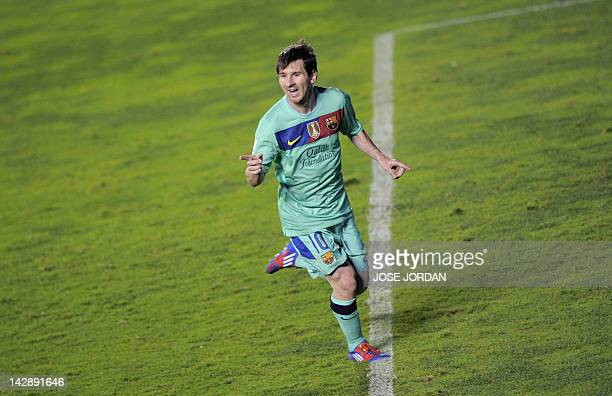 FC Barcelona's Argentinian forward Lionel Messi reacts after scoring during the Spanish league football match Levante UD vs Barcelona on April 14...