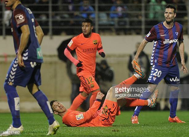 Barcelona's Argentinian forward Lionel Messi reacts after scoring during the Spanish league football match SD Eibar vs FC Barcelona at the Ipurua...